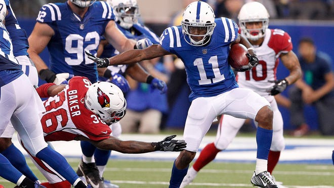Indianapolis Colts wide receiver Quan Bray (11) avoids the Arizona Cardinals defenders as he returns a kickoff in the second half of their game at Lucas Oil Stadium Sunday, Sept, 17, 2017. The Colts lost to the Cardinals 16-13 in overtime.