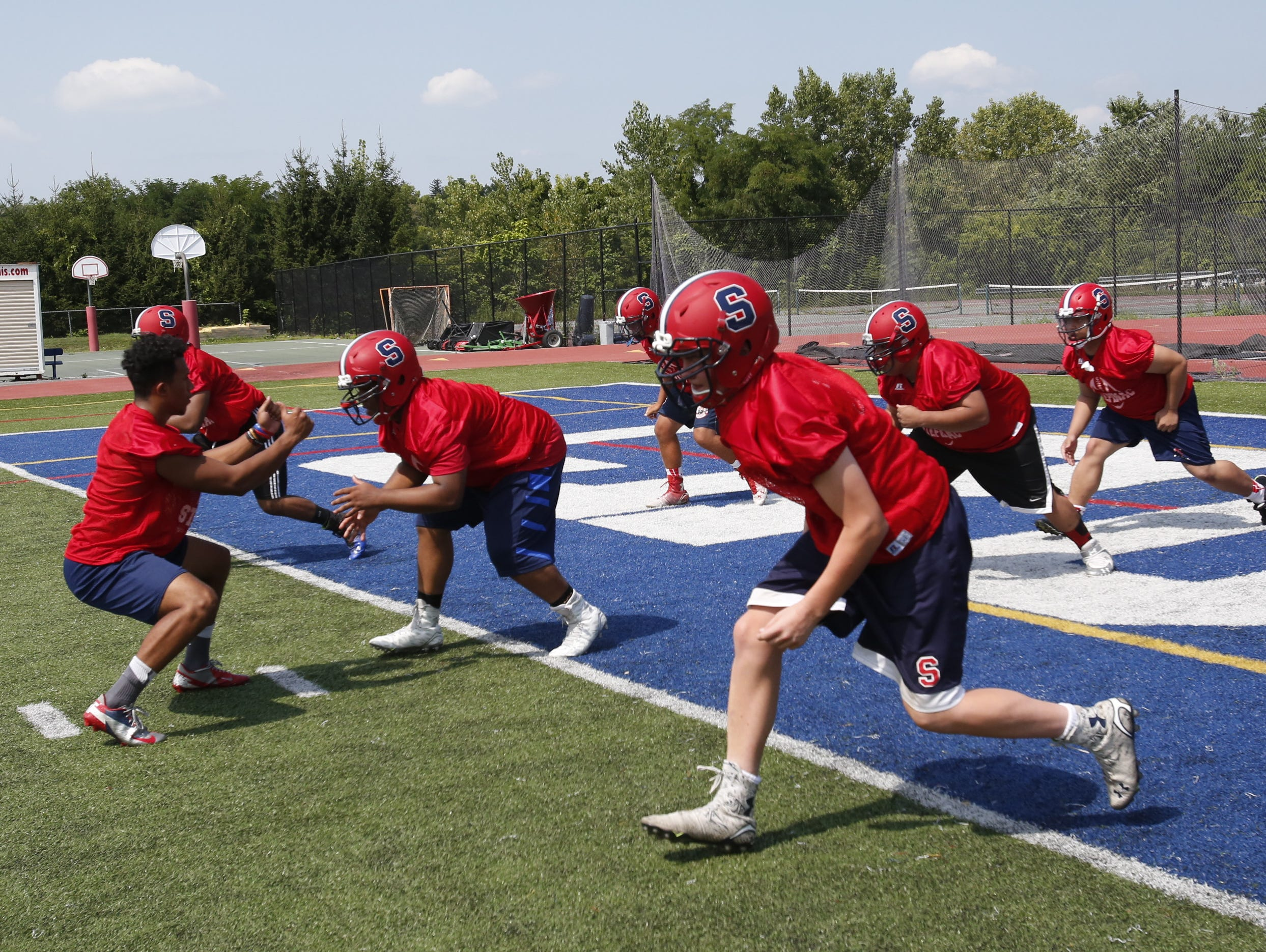 Archbishop Stepinac High School's football team go through drills during practice in White Plains on Aug. 24, 2015.