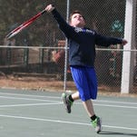 Cameron Allen, 9, keeps his eye on the ball during a tennis lesson at Kiroli Park in West Monroe on Monday. Allen said he started playing tennis when he was six.