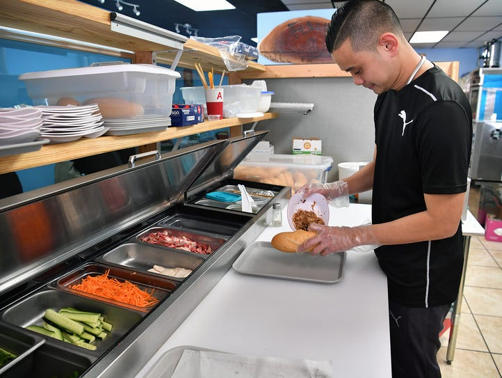 Thanh Tu, co-owner of Jasten's Ice and Banh Mi, makes