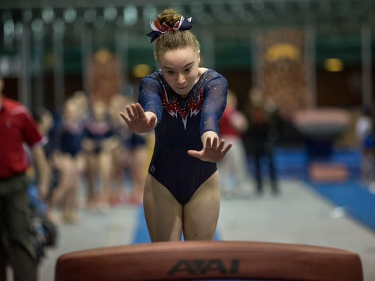 All American Flames' Julia Forestell, 12, competes in the vault during the WildFire Challenge gymnastics competition Saturday, Feb. 27, 2016 at McMorran Arena.