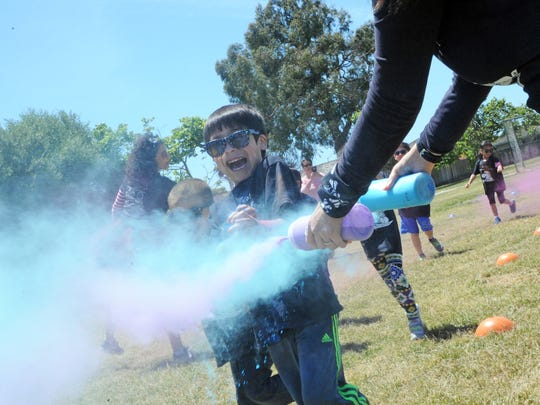 Clouds of blue and green greet this young runner at Mission Park Elementary School's Pirate Color Run on Wednesday in Salinas.