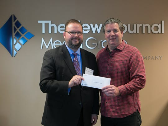 Jeff Jackson with Read Aloud Delaware receives a Gannett Foundation Grant from Thomas Donovan, President/Publisher and Northeast Regional President of Gannett East Group.