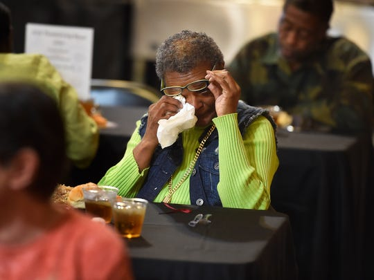 "Victoria Singleton wipes away tears as she eats her Thanksgiving meal at Watson Grove Missionary Baptist Church. Her mother died about 4 years ago and it's a sad time of year for her so she doesn't want to have Thanksgiving alone. ""This is the time I miss my mom the most"" Singleton said.