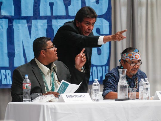 Navajo Nation presidential candidates Dineh Benally, left, and Norman Patrick Brown, right, talk with Navajo Times publisher Tom Arviso Jr. Monday during a candidates forum at Navajo Technical University in Crownpoint.