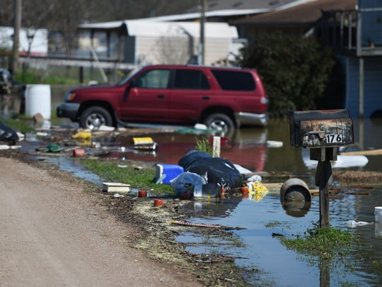Debris floats in floodwater along Short End Road in Caldwell Parish on Monday.