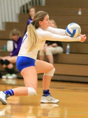 Bumping the ball during Monday's contest is Livonia
