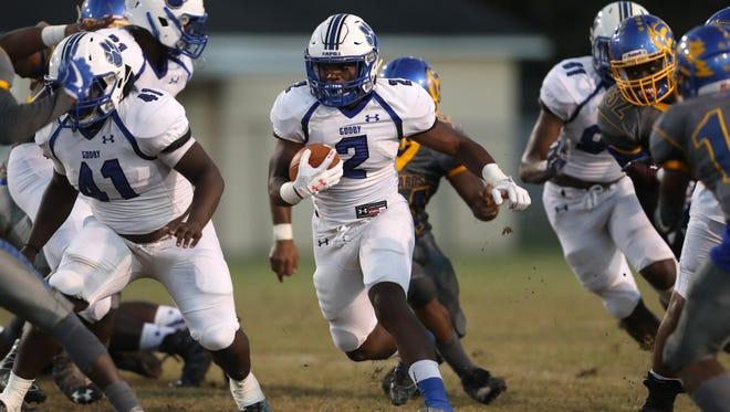 Godby's Tony Street runs the ball against Rickards during their game at Cox Stadium on Friday night.