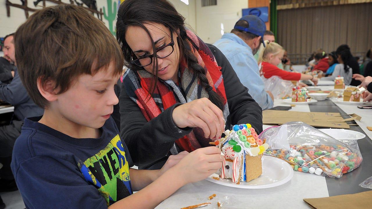 Fain Elementary third graders build gingerbread houses.