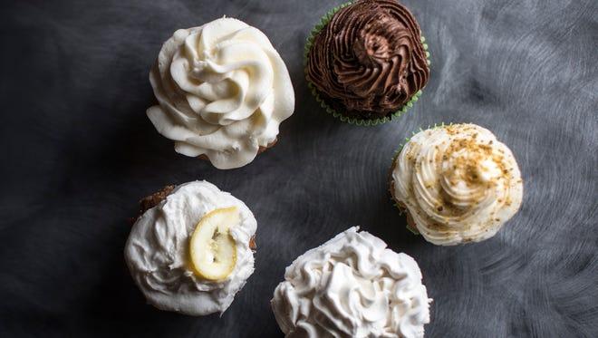 Clockwise from top left, Royal Wedding Lemon Elderflower Cupcake, Love Cupcake gluten-free and vegan, Pistachio Cupcake, Hershey Chocolate Cake Cupcake, and Pineapple Vanilla Cupcake.