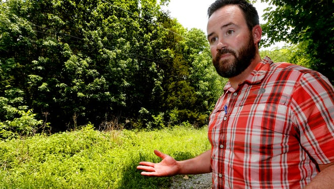 Nate Williams, assistant Murfreesboro Parks and Recreation director, shows off an area of Barfield Crescent Park on May 15, 2018, where a new bike trail might be built.
