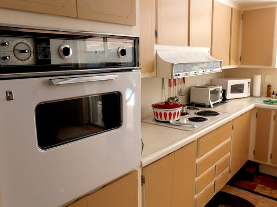 Original cabinets, oven, stove and hood are in the kitchen of a Michigan home in North Fort Myers.