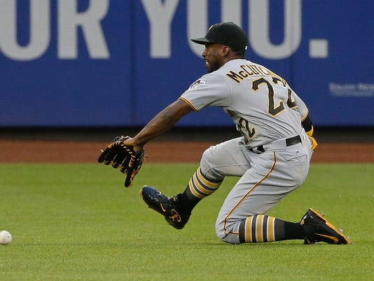Pittsburgh Pirates' Andrew McCutchen (22) attempts to catch a ball hit by New York Mets' Curtis Granderson for a single during the third inning of a baseball game Thursday, June 16, 2016, in New York. (AP Photo/Frank Franklin II)