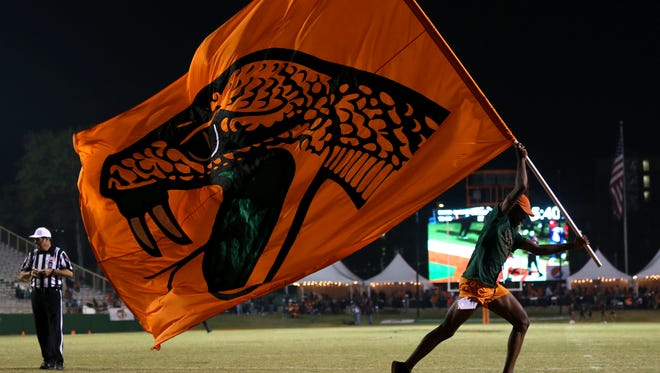 FAMU's Rattler flag is waved after a touchdown against Morgan State during at Bragg Memorial Stadium on Saturday, Nov. 12, 2016.