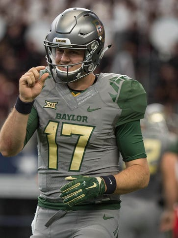 Baylor Bears quarterback Seth Russell (17) comes off