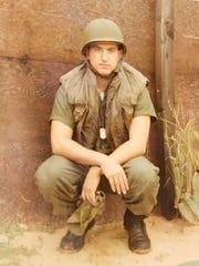 Mitchell Barnett as he served in Vietnam. Barnett was