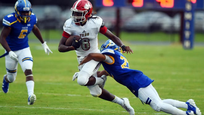 Vero Beach High School's Will Stribling moves the ball up the field Aug. 25, 2017, during the first quarter of a game against Oscar Smith in Virginia. The Fighting Indians won 28-21.