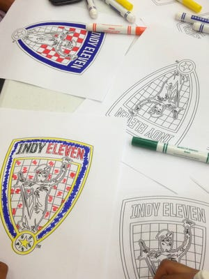 Children at the Chase Near Eastside Legacy Center colored in Indy Eleven logos.