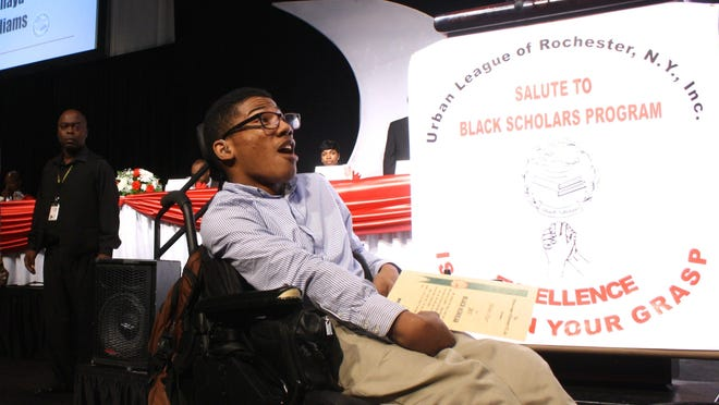 Julian Hiler, a senior at Wilson Commencement Academy, reads his name and college plans at the Salute to Black Scholars Recognition Dinner on June 9, 2015.