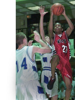 Demecos Bowman scores two of his 29 points in East's triple-overtime victory over Woodstock in the 2000 sectional semifinals.
