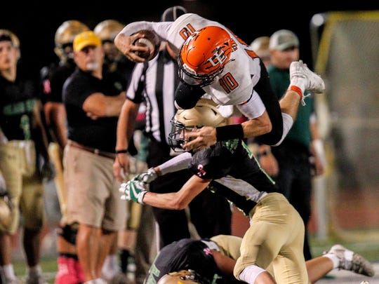 Union-Endicott's Devon Hogan goes flying over Vestal's Adam Mieczkowski in the second quarter at Vestal's Dick Hoover Stadium on Friday, October 6, 2017. 