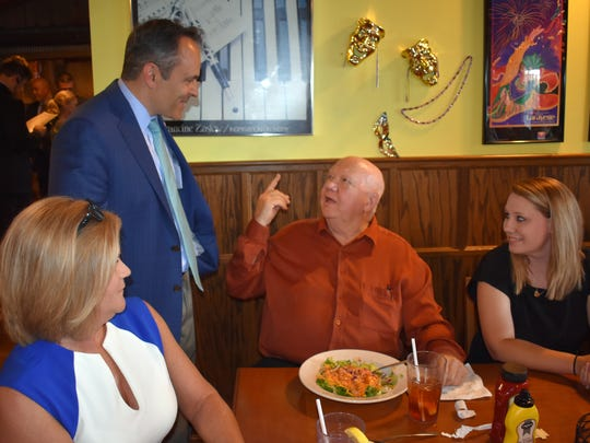 Morganfield resident Jerry Manning makes a point as he chats with Gov. Bevin Wednesday at The Feed Mill.