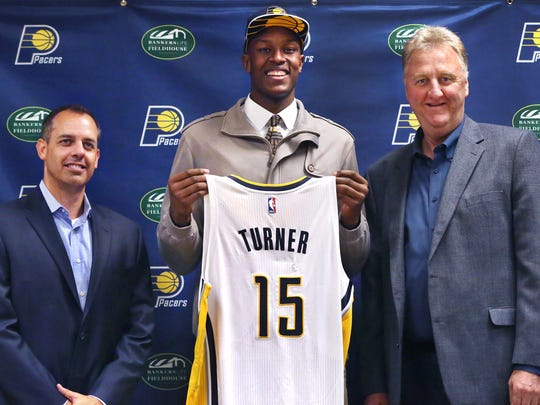 Larry Bird (right), Indiana Pacers President of Basketball Operations, and Coach Frank Vogel (left), pose for pictures with the team's top draft pick, Myles Turner.