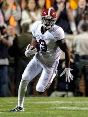 Alabama wide receiver Amari Cooper set an SEC record with 115 receptions this year and is one of three finalists for the Heisman Trophy.