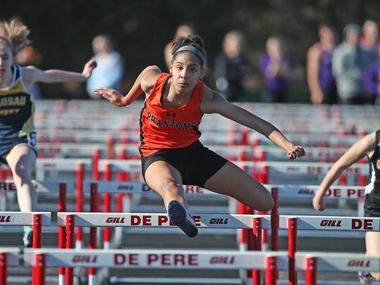West De Pere's Pehja Mitchell runs the 100-meter hurdles Friday at the Dan Baker Invite at De Pere High School. Mitchell won the event and reset her school record with a time of 15.41 seconds.