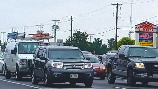 Cars line up on Route 13 on July 2. AAA predicts an increase in travelers July 4 weekend, in part due to cheaper gas and Bay Bridge tolls.