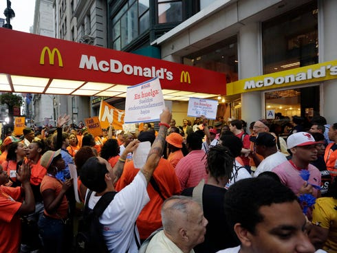 Protesting fast food workers demonstrate Aug. 29 outside a McDonald's on New York's Fifth Avenue.