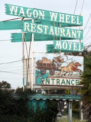 The old sign marks the entrance to the former Wagon Wheel restaurant and motel in Oxnard just before the property was demolished in 2011. The motel was located near Highway 101 and Oxnard Boulevard exit.