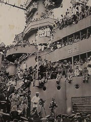 Alfredo Gomez told his family that he's somewhere in this photo of the USS Panamint.