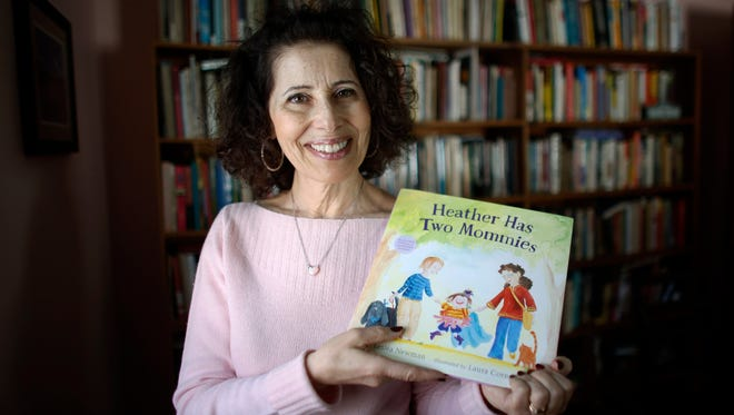 Author Leslea Newman with her book 'Heather Has Two Mommies,' in Holyoke, Mass.