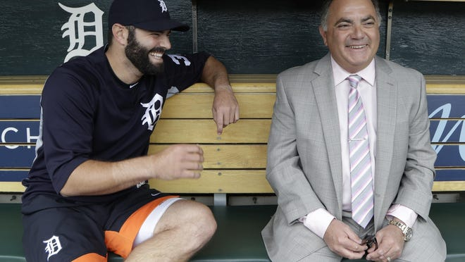 The Tigers' Alex Avila shares a laugh with his father and team general manager Al Avila.