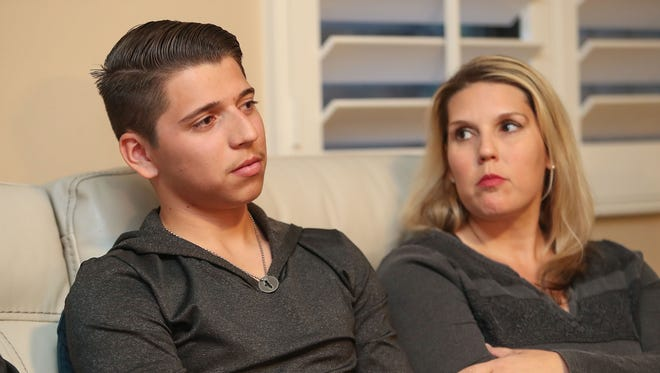 Kevin Salamone, left, pictured with his mother, Cera, suffered a traumatic brain injury during a 2017 high school soccer game. Fourteen months later, his mind is still recovering, and he says he is a shadow of his former self.