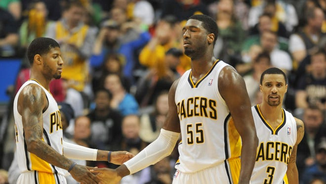 Indiana's Paul George, Roy Hibbert and George Hill on the floor in the closing minutes of the fourth quarter as the Indiana Pacers hosted the Philadelphia 76ers at Bankers Life Fieldhouse, March 17, 2014.