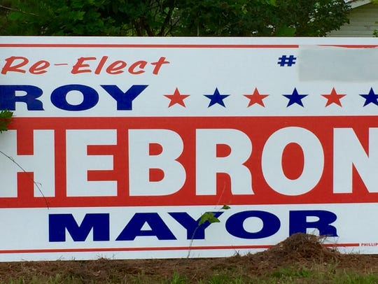Signs on U.S. Highway 165 advertise a run for mayor