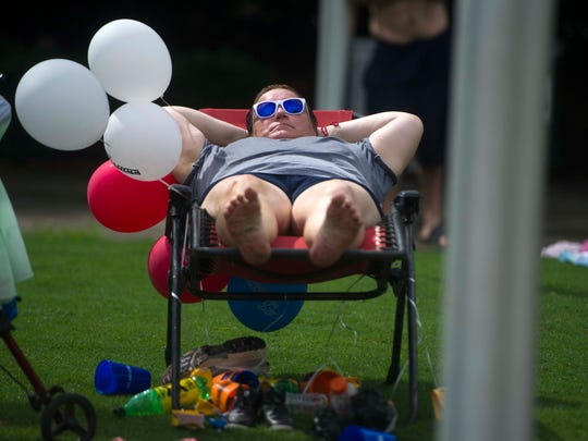 Effie Carver of Newport, Tenn. relaxes during the Festival on the Fourth celebration in World's Fair Park on Tuesday, July 4, 2017.