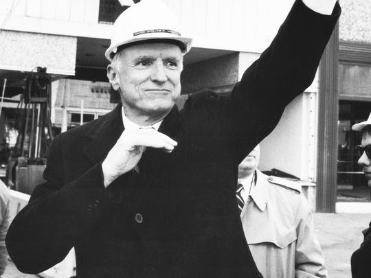 Mayor William Hudnut waves after officially starting demolition for the Circle Center Mall.
