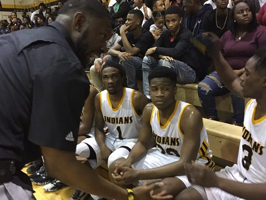 Fair Park coach Eddie Hamilton talks with his team during a timeout at Tuesday's District 1-4A contest with Woodlawn.