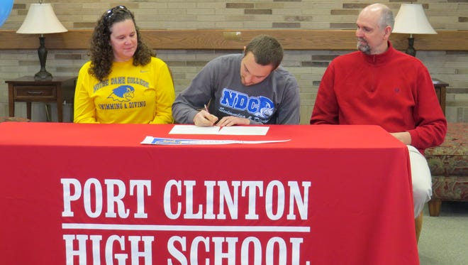 Port Clinton's Zach Barr will continue his swimming career at Notre Dame College. Barr's mother, Helena, and father, Bryan, watch him announce his decision.