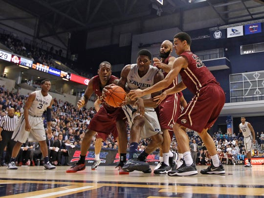 Xavier Musketeers forward Jalen Reynolds (1) holds a rebound during the second half against the IUPUI Jaguars at the Cintas Center. Xavier defeated IUPUI 66-43.