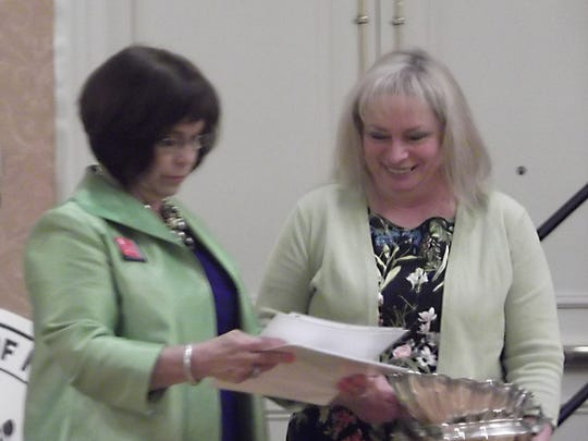 Susan O'Donnell, president of the Garden Club of New Jersey, presents awards to Michele Liana, president of Country Garden Club of High Bridge.