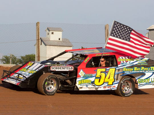 """Benji LaCrosse wheels his IMCA Modified around Luxemburg Speedway. LaCrosse is featured in one of the chapters in the new book by Joe Verdegan, """"Life in the Past Lane: The Next Generation."""""""