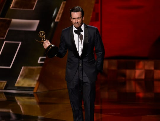 Jon Hamm accepts the Emmy for lead actor in a drama.