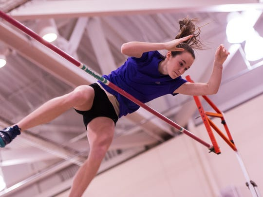 Erica Ellis of Gates Chili clears the bar at 11-9 to