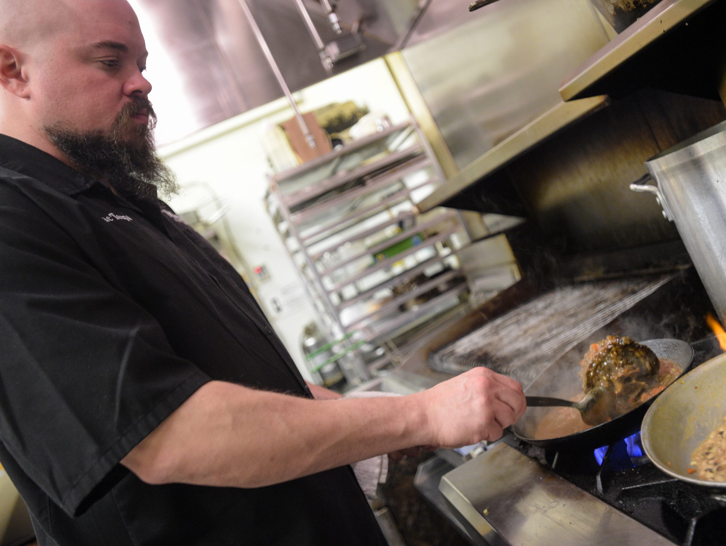 Isaac Toups prepares lamb neck ragout at his restaurant