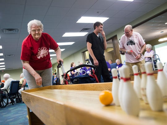 Jean Gailit, 85, competes in miniature bowling during the annual Sunshine Olympics at the United Methodist Homes Hilltop Campus in Johnson City on Wednesday.