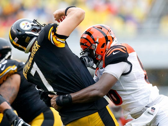 Steelers quarterback Ben Roethlisberger is brought down by Bengals defensive end Carlos Dunlap during Cincinnati's Sept. 18 loss.